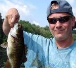 Fisherman w small mouth bass