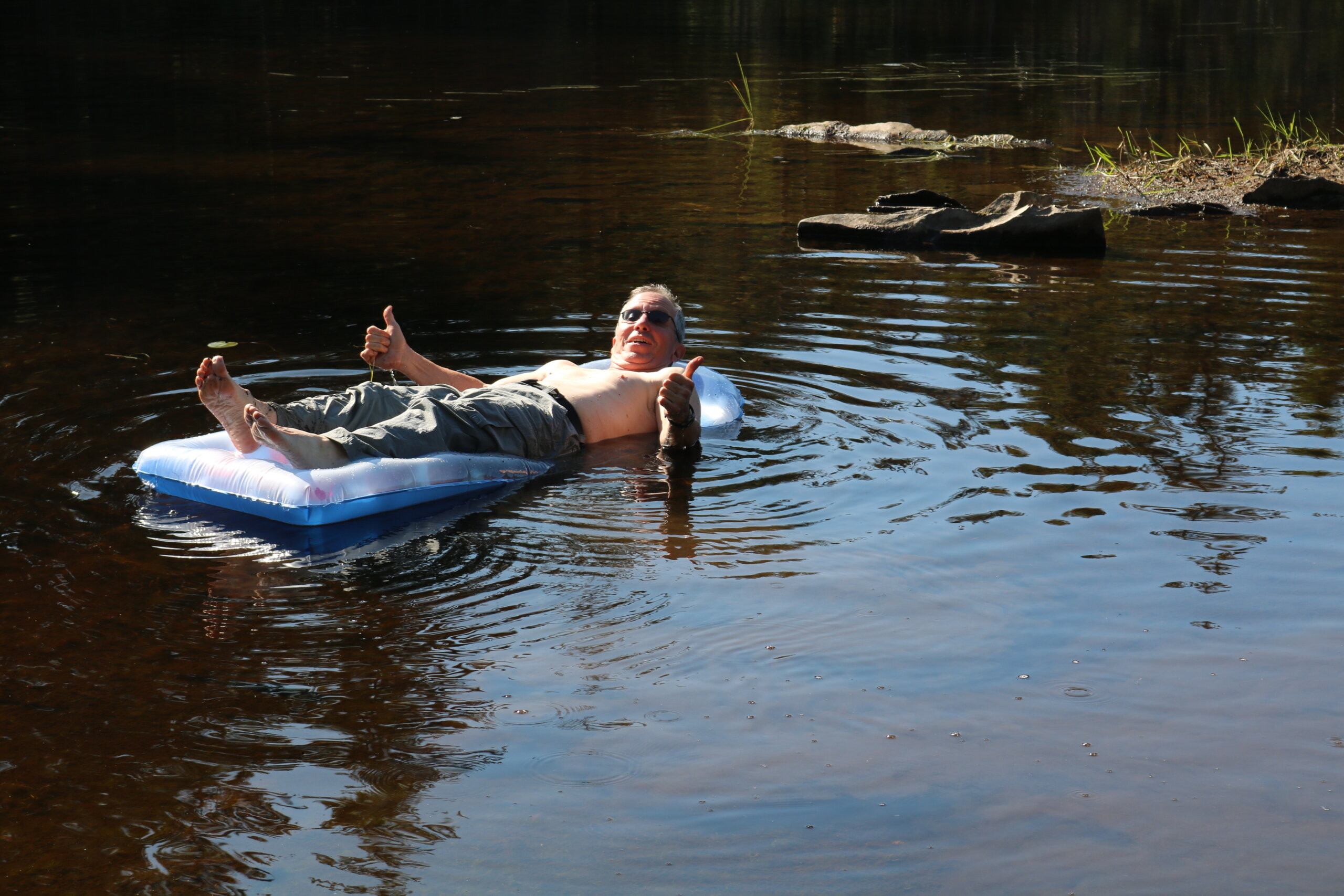 """""""Paddling"""" out onto 4th CT Lake on a Pool Raft, by Tim Lewis"""